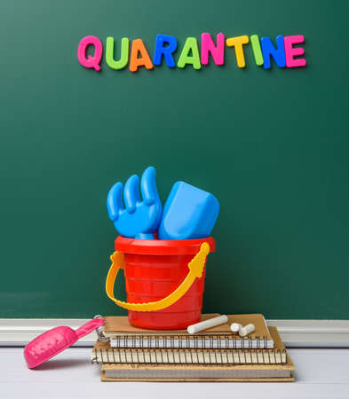 inscription quarantine from multi-colored plastic letter on a green chalk board, closure of schools and kindergartens during the epidemic Stock fotó