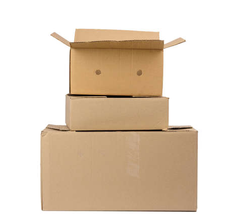 stack of closed cardboard brown paper boxes isolated on white background, moving concept