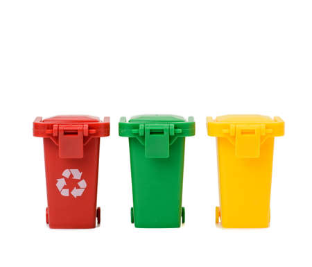 three multi-colored plastic containers on a white background, concept of correct sorting of garbage for further recycling