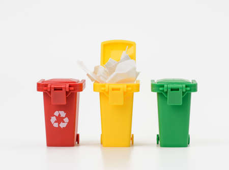 three multi-colored plastic containers on a white background, the concept of correct sorting of garbage for further recycling