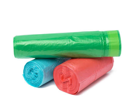 stack of polyethylene multicolored disposable trash bags on white background, close up 免版税图像