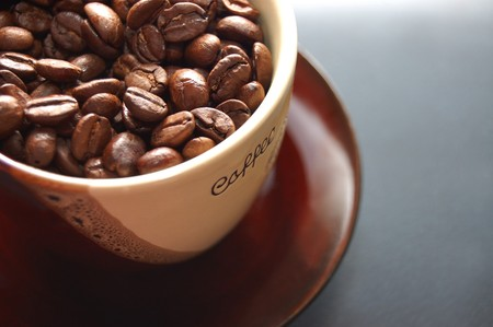 Coffee beans in cup photo