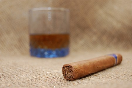 Cuban cigar and glass with wiskey on sackcloth Stock Photo - 4403028