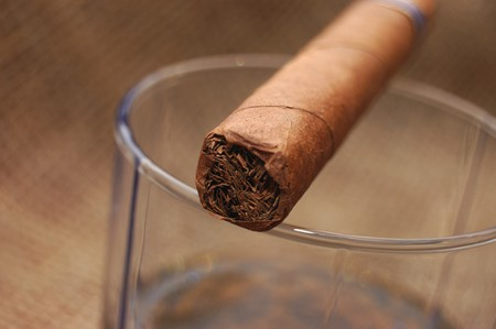 unhealthful: Cuban cigar on glass with wiskey