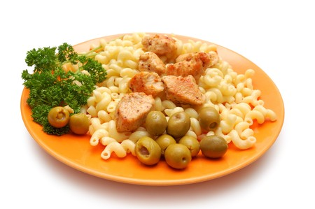 Pieces of fried chicken, pasta and parsley on orange plate photo