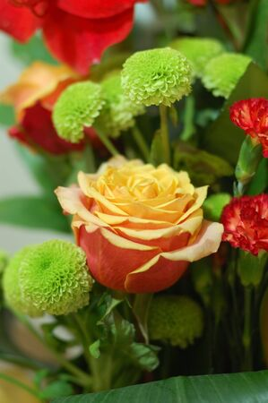 Colourfull bouquet with yellow-pink rose on focus photo