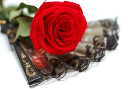 Black flamenco fan and red rose photo