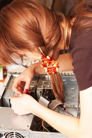 Woman engineer is repairing computer photo