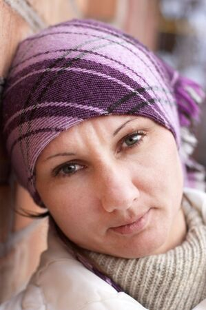 Portrait of adult woman in lilac headscarf photo