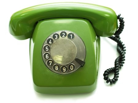 Green old-fashioned telephone on white background