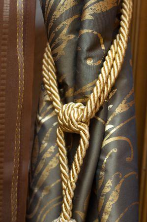 Gold knot on luxury cutrain tassel Stock Photo - 4754249