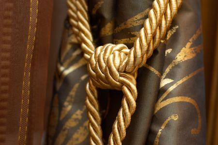 Gold knot on luxury cutrain tassel