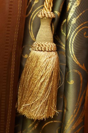 yellow tassel: Gold  tassel  and knot on luxury cutrain