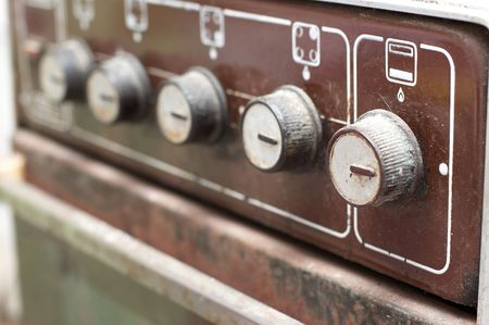 old gas stove: Switches of old rusty gas cooker