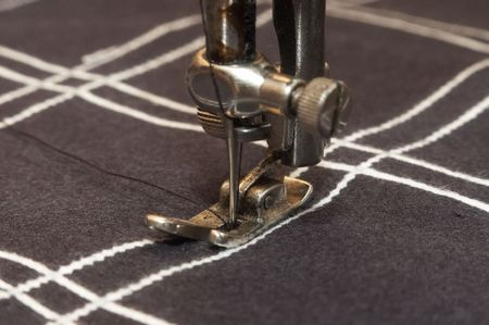 string together: Old stitching machine stitch checked material