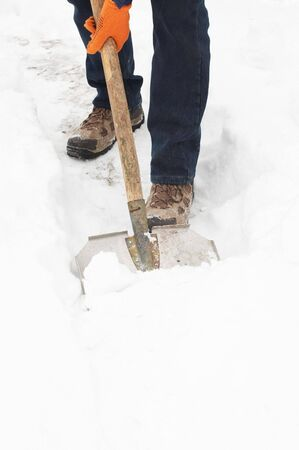 clearing the path: Man digging a path from the snow  Stock Photo