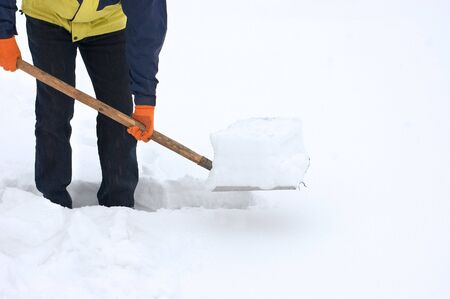 clear path: Man digging a path from the snow  Stock Photo