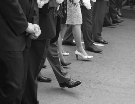 People walking throught urban street photo