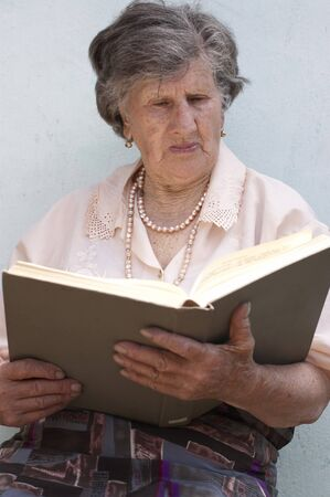 80 85: Old woman (85 years) reading book