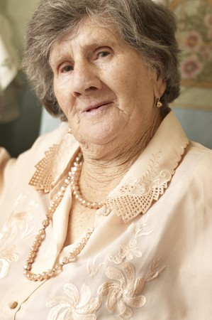 Smiling woman in age of 85 years photo