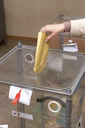 political system: Election: ballot box and hand putting a ballot inside, elections concept, voting concept