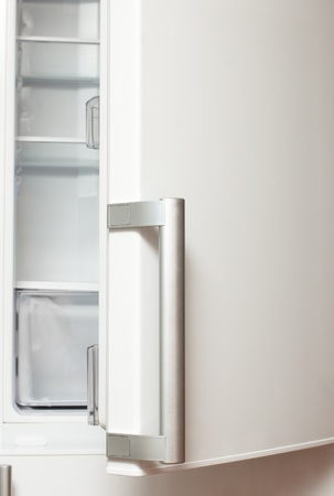 Open door of empty refrigerator photo