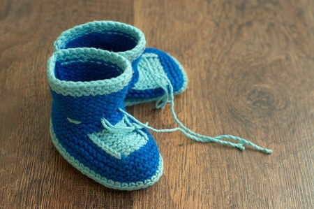 baby shoes: Knitted handmade baby Stock Photo