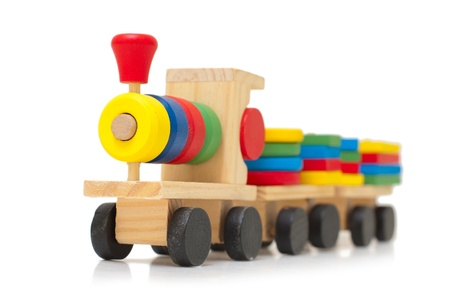 wood railroads: Colorful wooden train toy for developing of baby logic Stock Photo