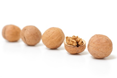 kine: Open walnut in kine with closed nuts. Concept of unique. Focus on core.