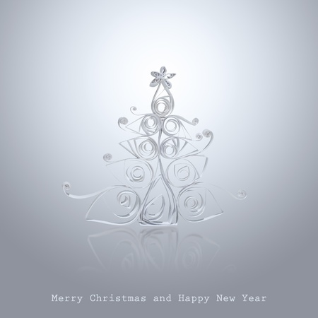 Handmade Christmas tree cut out from office paper. Quilling art. photo