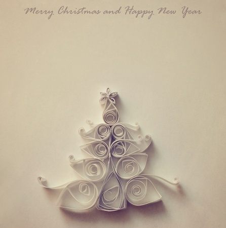 Handmade Christmas tree cut out from paper. Retro stylized. photo