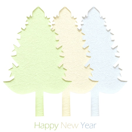 Handmade Christmas trees cut out from paper.  photo