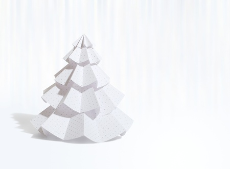 Handmade Christmas tree cut out from office paper  photo