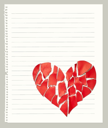 Broken paper heart on notebook page with empty space for text photo