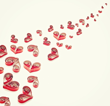 quilling: Handmade hearts cut from red paper. QUilling art.