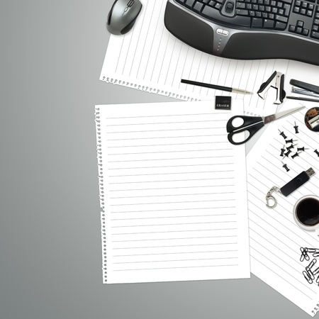 Office table with stationery accessories, keyboard and empty paper for your text photo
