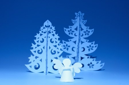 Handmade angel and Christmas tree cut out from  paper photo