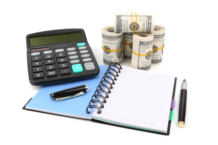 notebook, pen, calculator and dollars banknotes isolated with soft shadow over white background Stock Photo - 16128774
