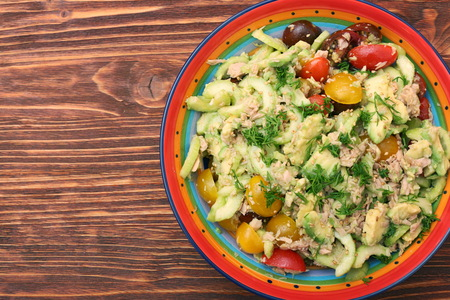 muscle gain: Low carbs Tuna Avocado Salad in glass bowl.