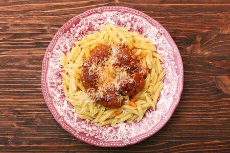 marinara sauce: Meatballs with pasta on the plate