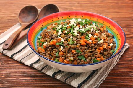 Lentil with carrot and onion in bowl Stock Photo