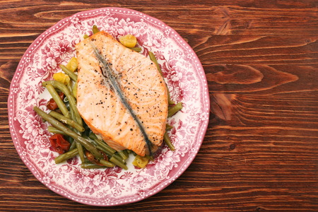 Salmon steak, veggies and herbs.