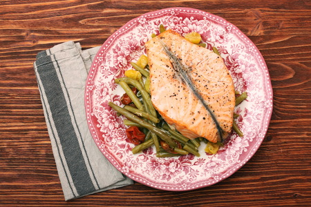 Salmon steak, veggies and herbs. Healthy eating concept Stock Photo