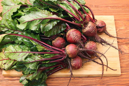 Fresh vegetables beetroot on wooden background. Stock Photo