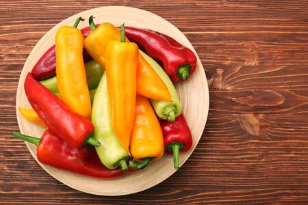 Fresh colored sweet peppers on the plate Stock Photo