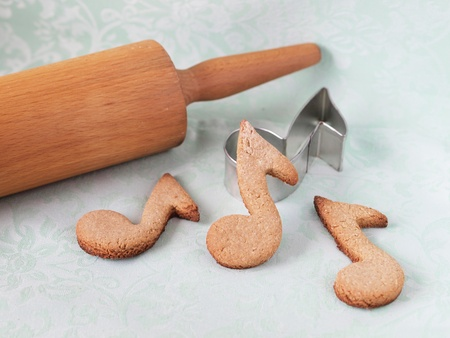 oatmeal cookie: Oatmeal cookies shaped as notes on a green background