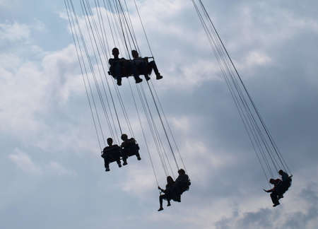 People on a flying swing      photo