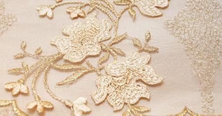lace gloves: Golden textile wedding background Stock Photo