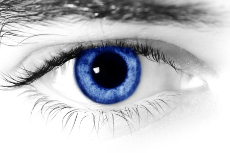 Close up of a mans blue eyes