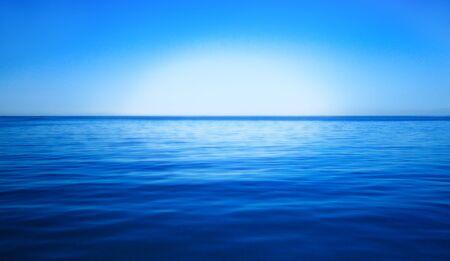 sky dive: sun, blue sky and ocean